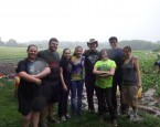 CLI students and staff at Drumlin Farm in Lincoln, MA, after pulling weeds in the pouring rain and thick  mud