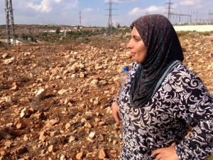 Shirim in her field near Husan Village, taken by author Jenn Lindsay