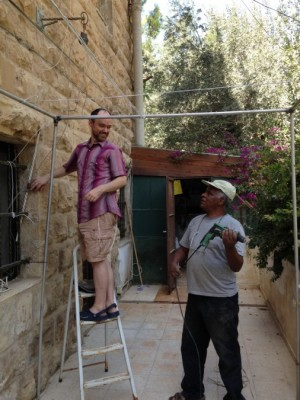 Building a sukkah this year in Jerusalem with neighbor Berhanu Yoseph