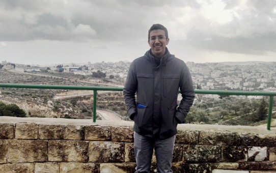 The author, standing at the end of Gilo, Jerusalem with Beit Lechem visible in the background.