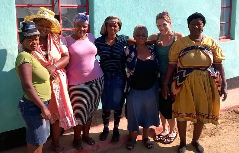 Members of the Rural Women's Movement and participants of a Christian single mothers' focus group gather for a photo. RWM founder and leader Sizani Ngubane is fifth from the left in sunglasses. The author is standing next to her, second from the right. Attribution: Haley Feuerbacher