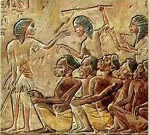 Relief of Egyptians Beating Slaves. Public Domain.