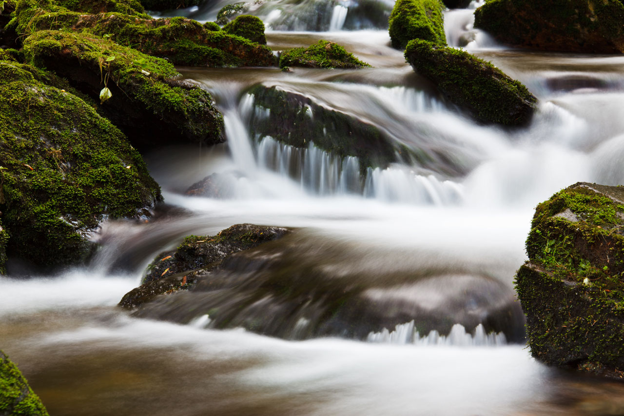 Blurred water effect done by long exposure. Picture of a stream on Bila Opava walk in Czech Republic